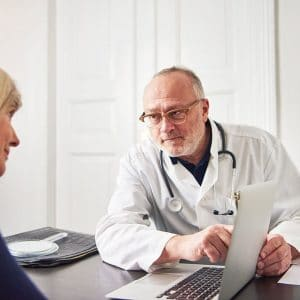 medic-explaining-diagnosis-to-woman